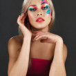 Beautiful young woman with creative make-up — Stock Photo