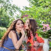 Two beautiful women at cafe — Stock Photo
