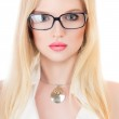 Beautiful young serious woman in glasses — Stock Photo #28164955