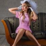 Beautiful woman sitting on sofa — Stock Photo
