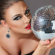 Woman with disco ball — Stock Photo