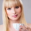 Young woman with tea — Stock Photo