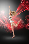 Woman dancing with flying fabric — Stock Photo