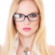 Beautiful young serious woman in glasses — Stock Photo #28637457