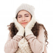 Woman in warm clothing on white background — Stock Photo