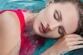 Young woman beauty portrait in water — Stock Photo