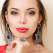 Beautiful woman with evening make-up and jewelry — Stock Photo