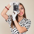 Young woman making photos with vintage film camera — Stock Photo #31052501