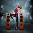 Woman dancing against of powerful speakers — Stock Photo #31387813