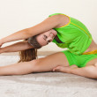 Woman doing stretching exercises on the floor at the gym — Stock Photo