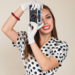 Young woman making photos with vintage film camera — Stok fotoğraf