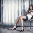 Fashion young woman sitting on chair — Stock Photo