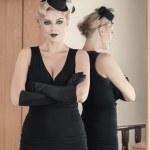 Elegant woman posing near mirror — Stock Photo