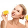 Young woman with orange in her hands — Stock Photo