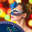 Beautiful young woman in venetian carnival mask — ストック写真