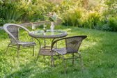 Table and two chairs in a garden — Stock Photo