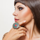 Young woman with big Indian ring — Stock Photo