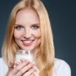 Young woman with milk — Stock Photo