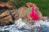 Fashion model posing at sea — Stock Photo