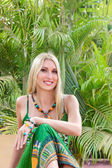 Young blonde woman at tropical resort — Stock Photo