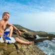 Man sitting near sea — Stock Photo