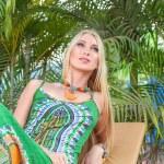 Young blonde woman at tropical resort — Stock fotografie
