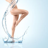 Young woman with water splash — Stock Photo