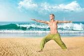 Man meditating in warrior pose — Stock Photo