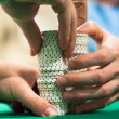 Hands Stacking Poker Chips — Stock Photo