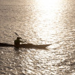 man kayaking in the lake at sunset — Stock Photo #34095105
