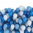 Blue and white balloons on white background — Stock Photo #34224843