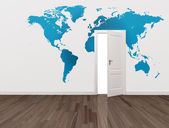 World map on wall and open door — Stock Photo