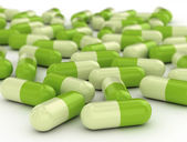 Green pills - medical background — Stock Photo