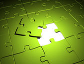 Green puzzle the last missing piece — Stock Photo