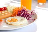 Breakfast meal focus center fried egg. — Stock Photo