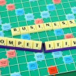 Stock Photo: Business wording in queue scrabble on game board.