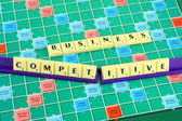Business wording in queue scrabble on game board. — Stock Photo