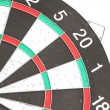 Old dartboard with damage hole. — Stock Photo