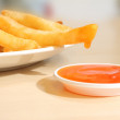 French fried dipped sauce on table. — Stock Photo #34238259