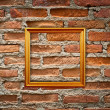 Empty frames on brick wall — Stock Photo