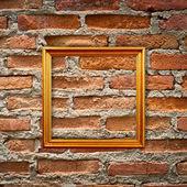 Empty frames on brick wall — Stock Photo