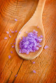 Violet sea salt for spa in wooden board — Stock Photo