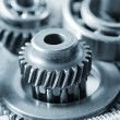 Stock Photo: Industrial gear machinery, engineering parts in blue toning