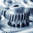 Industrial gear machinery, engineering parts in blue toning — Stock Photo #14311979