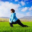 Woman doing fitness stretching outdoors — Stock Photo #14314913