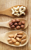 Nuts in spoon — Stock Photo
