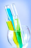 Test tubes filled with colored liquids — Stock Photo