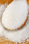 Sugar in a wooden spoon — Stock Photo