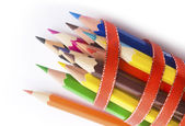 Colored pencils in a ribbon — Stock Photo