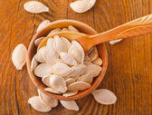 Pumpkin seed in wooden spoon, healthy food ingredient — Stock Photo